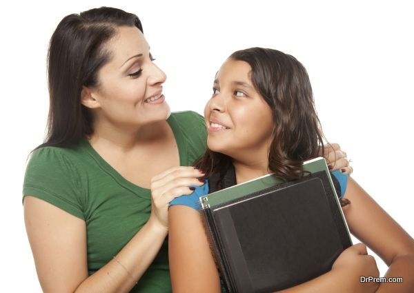 Hispanic Mother and Daughter Ready for School Isolated on a White Background.