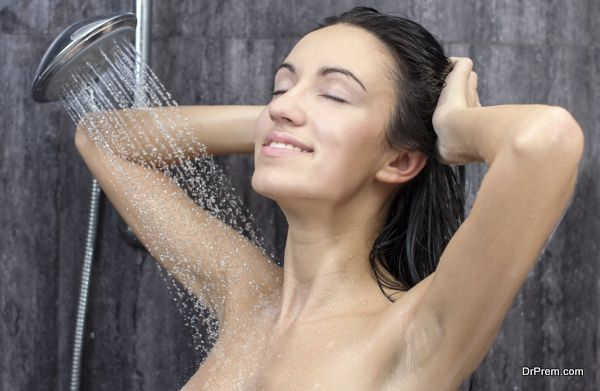 sexy and happy young beautiful woman taking a shower