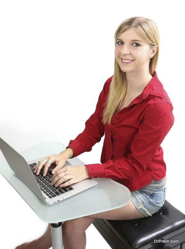 Blonde girl working on a computer
