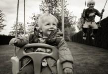 baby swinging in the garden