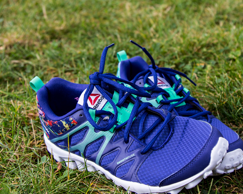 Royal blue running shoes on lawn preparing to Race for Virtue