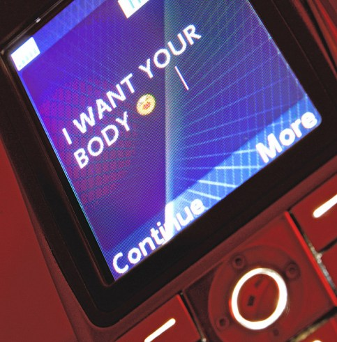 B9428N Sexual harassment by text message (w/o phone manufacturer's logo).. Image shot 2009. Exact date unknown.