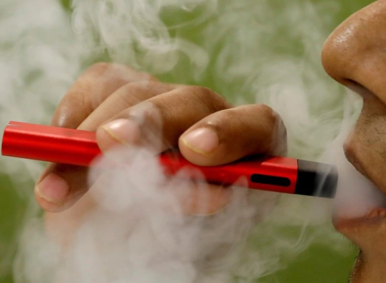 Pictured here is someone smoking an e-cigarette.