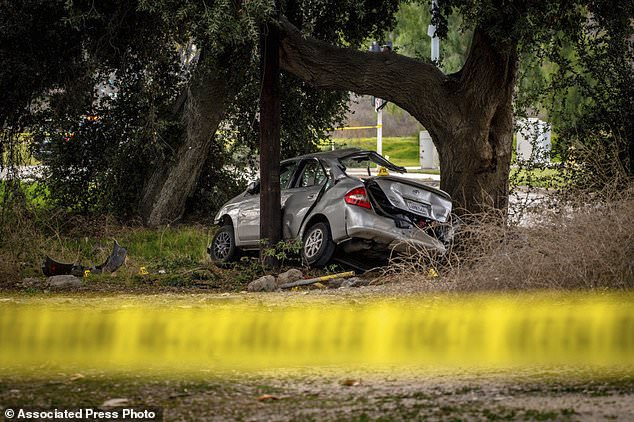 The teenagers' Toyota Prius is seen here after the crash. When authorities arrived, they found three of the boys had escaped from the car, while the other three were stuck inside
