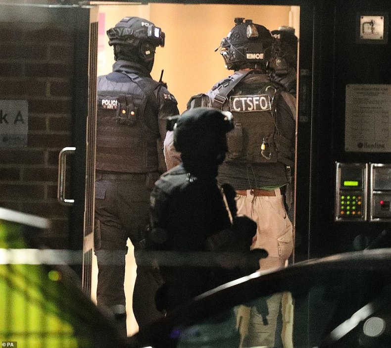 Counter-terrorism police raided a block of flats in Reading after a frenzied stabbing attack left three people feared dead and another three seriously injured