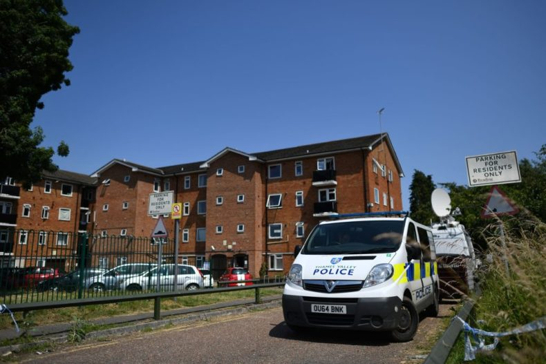 A police van is parked outside a cordoned off block of flats where the suspect of a multiple stabbing incident lived in Reading. (BEN STANSALL/AFP via Getty Images)