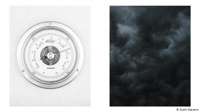 Photo from the series 'Under Pressure': dark sky, clouds illuminated by moonlight, picture of a barometer with the needle pointing: FAIR (Scott Stevens)