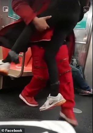 Sonny Alloway, dressed in red, at first tried to wake the woman as she slept on the train