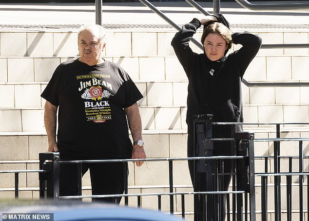 Pictured: Monica Young attending Bankstown Police Station with her father as a part of her Bail conditions