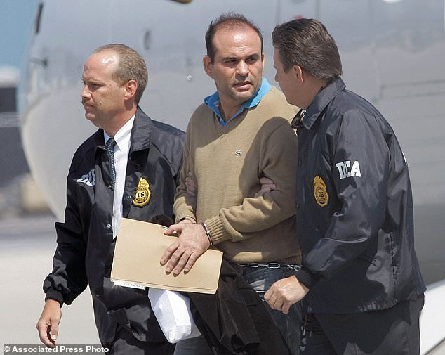 File image from May 13, 2008 shows Salvatore Mancuso (center) escorted by U.S. Drug Enforcement Agency agents in Opa-locka, Florida
