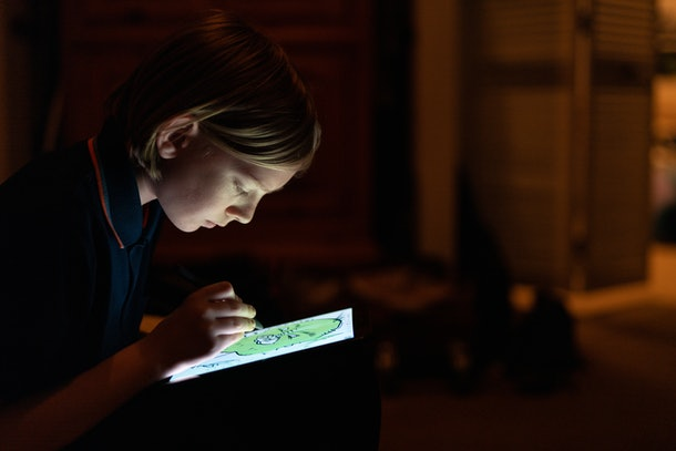tween on tablet in dark