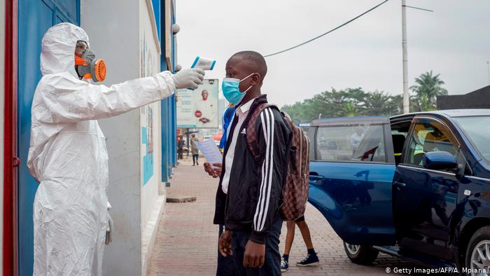 A pupil gets his temperature measured before entering the Reverend Kim School (Getty Images/AFP/A. Mpiana)