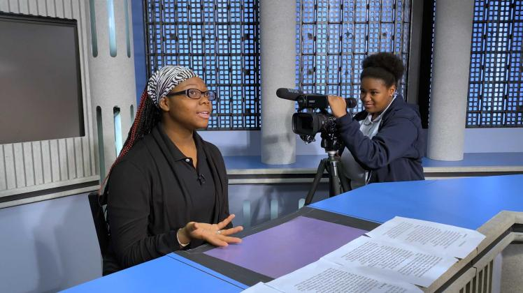 "Michaela Dunagin filming her piece for the NTARUPT annual student film festival, where local high school students create short films about the sexual and reproductive issues affecting them. | Still from ""Global Mosaic"" episode ""Young Women Rising"""