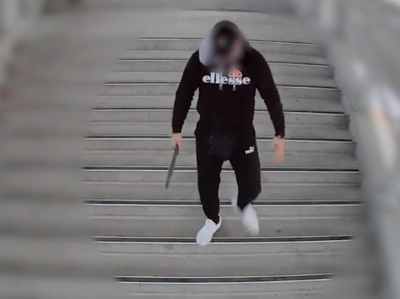 Friday 12 June 2020: A young male, allegedly armed with a machete, walks on to the platform at Rooty Hill Railway Station in front of terrified commuters before he was confronted by four teenage males armed with knives and a hammer. Picture: NSW Police