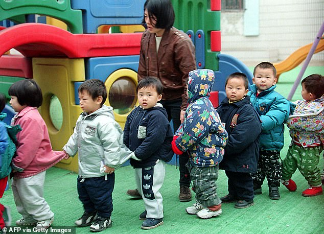 Schoolchildren in China have been the target of often fatal attacks by people bearing grudges or considered mentally ill. The file photo shows Chinese children lining upunder the supervision of a teacher at a kindergarten playground in Beijing