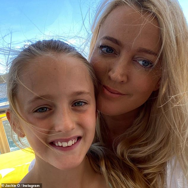 Candid:Dr Justin Coulson spoke to Daily Mail Australia about the dilemma faced by many parents after radio host Jackie 'O' Henderson (right) revealed on air earlier this week that she'd had to explain to her nine-year-old daughter, Kitty (left), what 'WAP' meant