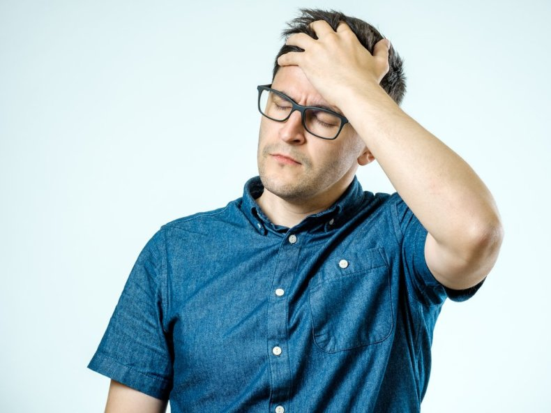 A photo of a frustrated man holding his head.   Photo: Shutterstock