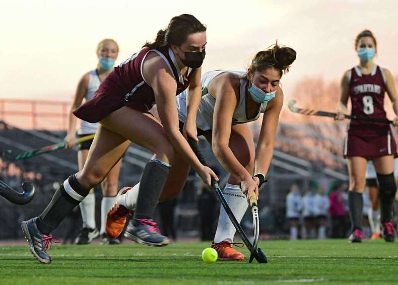 Burnt Hills' Hanna Pochobradsky, left, battles with Shenendehowa's Sydney Reinisch during the Suburban Council field hockey final on Friday, Nov. 20, 2020 in Clifton Park, N.Y. (Lori Van Buren/Times Union)
