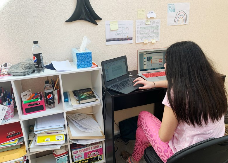 Hannah, 12, works on her computer at home. In the fall, she began receiving speech and behavioral therapy online. Photo courtesy of Claire Lazaro