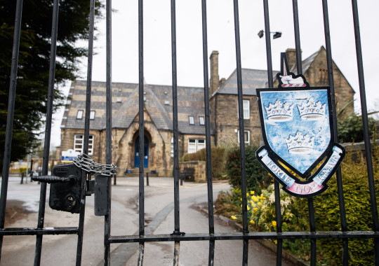 Chained gates at Batley Grammar School in Batley, West Yorkshire, where a teacher has been suspended for reportedly showing a caricature of the Prophet Mohammed to pupils during a religious studies lesson. Picture date: Friday March 26, 2021. PA Photo. See PA story EDUCATION Batley . Photo credit should read: Danny Lawson/PA Wire