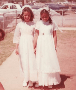 "Clients Diana Alamader-Douglas and ""Jane Doe"" at their first communion outside of St. Bernard Catholic Church in Pirtleville, AZ."