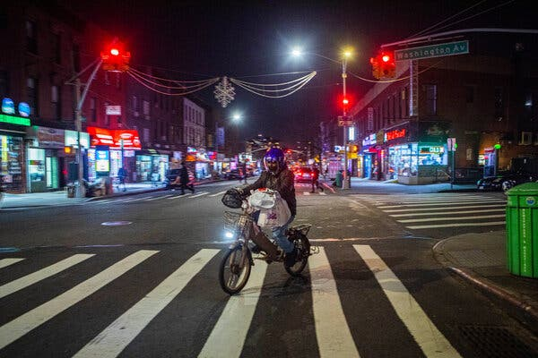 Delivering items in New York in January. Workers have often been targeted for their electric bikes, which can cost thousands of dollars.