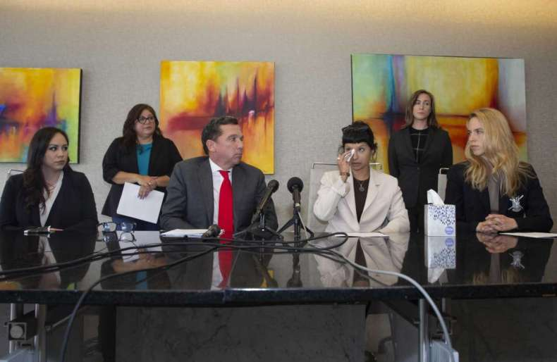 Ashley Solis, second right, the first woman to file sexual assault claims against Houston Texans quarterback Deshaun Watson, gives a statement during a news conference with attorney Tony Buzbee and his legal team, Tuesday, April 6, 2021, in Houston.