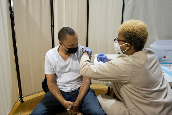 Ashai McLean, a nurse, administers a vaccine dose to Miguel Sanchez at the Bronx River Community Center last week in New York.