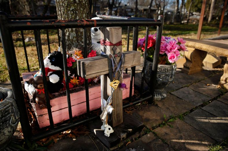 A memorial for Amber Hagerman, the little girl who was abducted on her bike and later found dead in Arlington in 1996, has accumulated near the crime site as the 25th anniversary of the cold case crime nears. Because of this case, the Amber Alert was created to ask the public for help in finding abducted children. (Tom Fox/The Dallas Morning News)