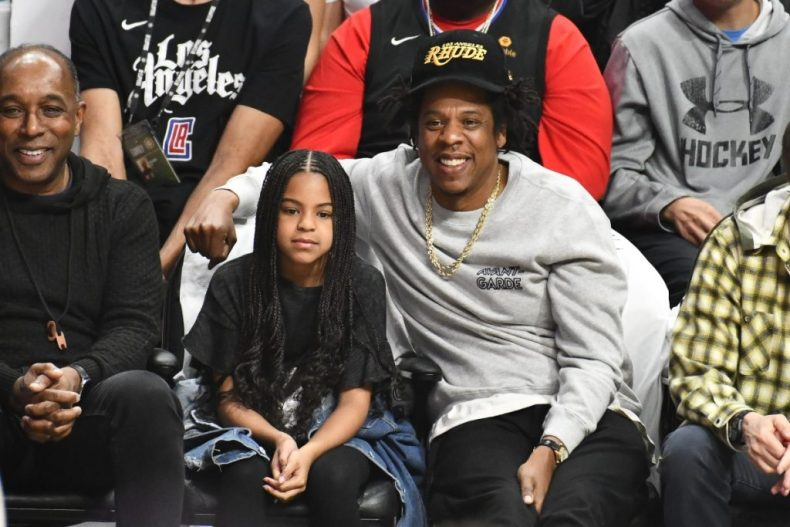 Jay-Z and Blue Ivy Carter attend a basketball game between the Los Angeles Clippers and the Los Angeles Lakers, March 2020
