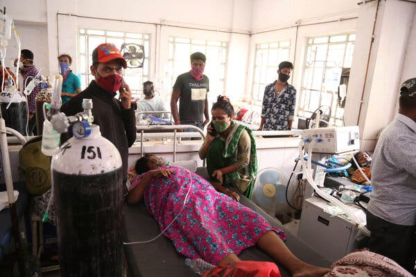 A patient used an oxygen cylinder in a hospital in the western state of Maharashtra on Wednesday. A leak in the hospital's main oxygen supply caused the deaths of more than 20 people.