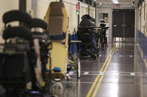 Specialized equipment for students at Pioneer Education Center lines the hallways.