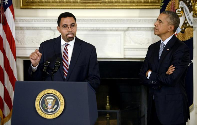 WASHINGTON, DC - OCTOBER 02: Deputy Education Secretary John B. King Jr. (L) delivers remarks after being nominated by U.S. President Barack Obama (R) to be the next head of the Education Department in the State Dining Room at the White House October 2, 2015 in Washington, DC. Obama praised the work of outgoing Education Secretary Arne Duncan, one of the few remaining members of the president's original cabinet. (Photo by Olivier Douliery - Pool/Getty Images)