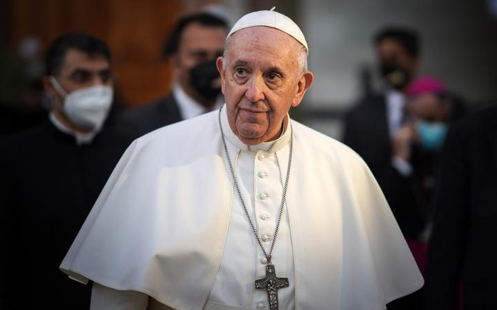 Pope Francis leaves the Syriac Catholic Cathedral of Our Lady of Salvation (Sayidat al-Najat) in Baghdad at the start of the first ever papal visit to Iraq on March 5, 2021.