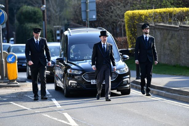 Funeral cortege passes by for William Murdock (the former head of Danes Hill School, Oxshott).