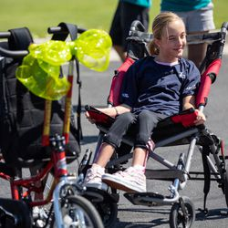 Audrey Sterner, 13, smiles after receiving a new adaptive tricycle at Germania Park in Murray on Wednesday, July 21, 2021. Sterner received the trike from a partnership between Wasatch Adaptive Sports, The Hartford and Move United.