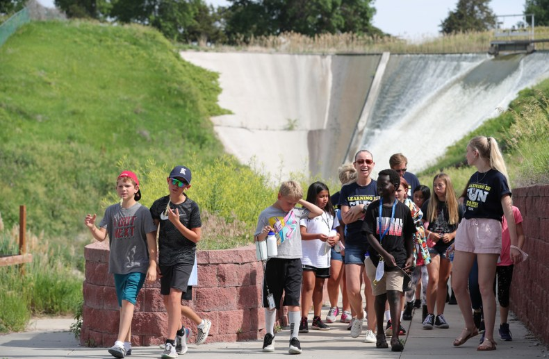 Students attending the PAWS University Prep Academy visit the Kearney Canal spillway on the UNK campus while learning about water.