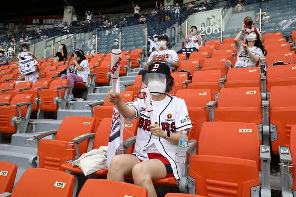 Fans at a Korea Baseball Organization league game last summer in Seoul. In the Asia Pacific region, vaccination rates are relatively low, the Delta variant is surging and several countries are reimposing lockdowns.