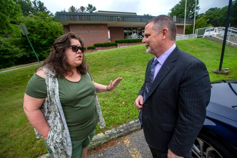 Laura Wojcechowicz speaking with her attorney Joseph Hennessey outside of the Second District Courthouse of Southern Worcester County in Uxbridge. (Jesse Costa/WBUR)