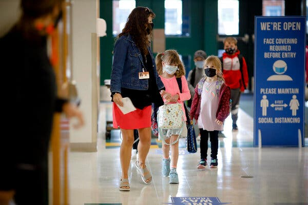 Under the current plan, nearly all public school students over age 5, regardless of vaccination status, will be expected to wear masks at school until at least October.