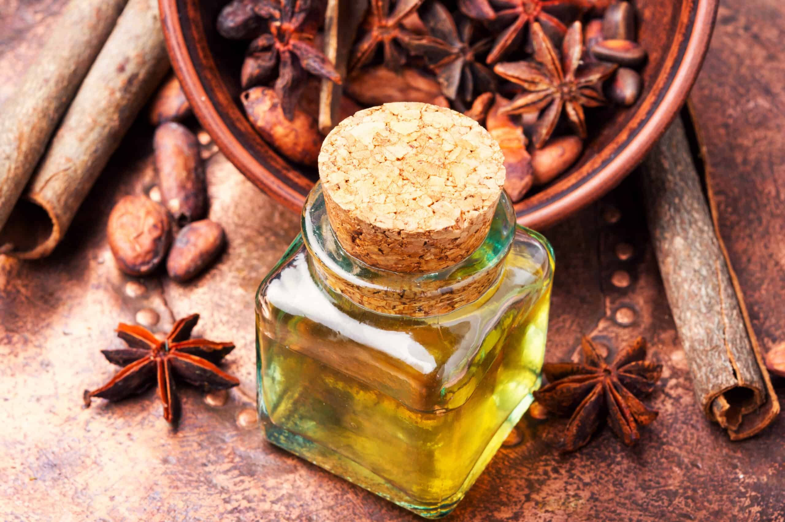 Essential oil with cinnamon and anise in bottle