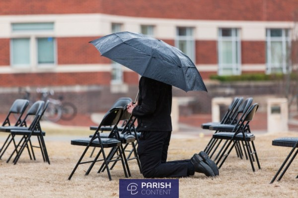 Seminarian In Adoration In The Rain