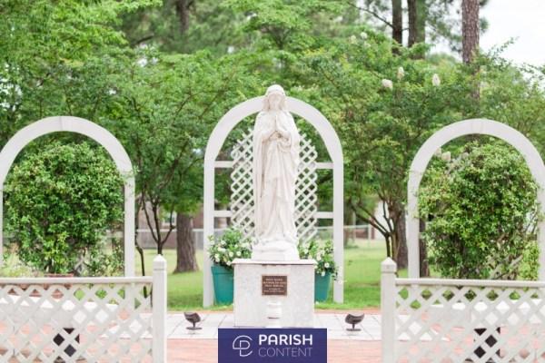 Statue In Church Garden