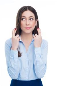 Businesswoman crossing her fingers
