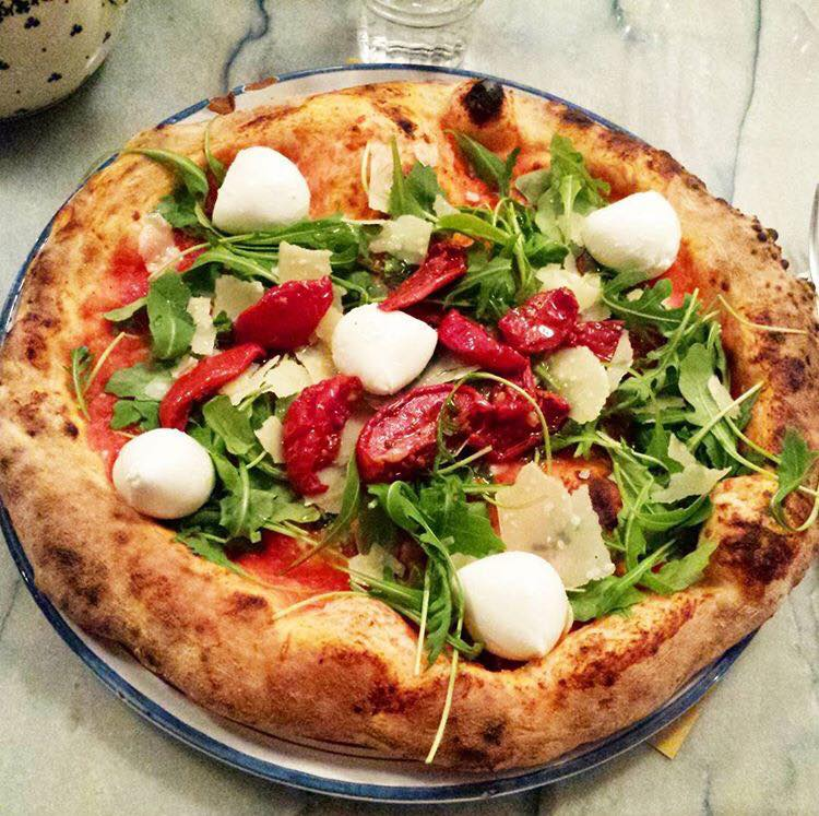 Traditional Naples-style woodfired pizza at East Mamma in Paris. Image: East Mamma/official Facebook page