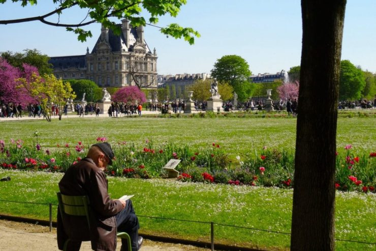 Things start to thaw in March-- including people. Strolling or sitting to read in a city park is always a good idea. Image: Jeanne Menjoulet/Creative Commons