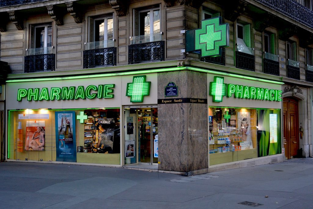 Paris pharmacies can be identified by their bright, flashing green crosses.