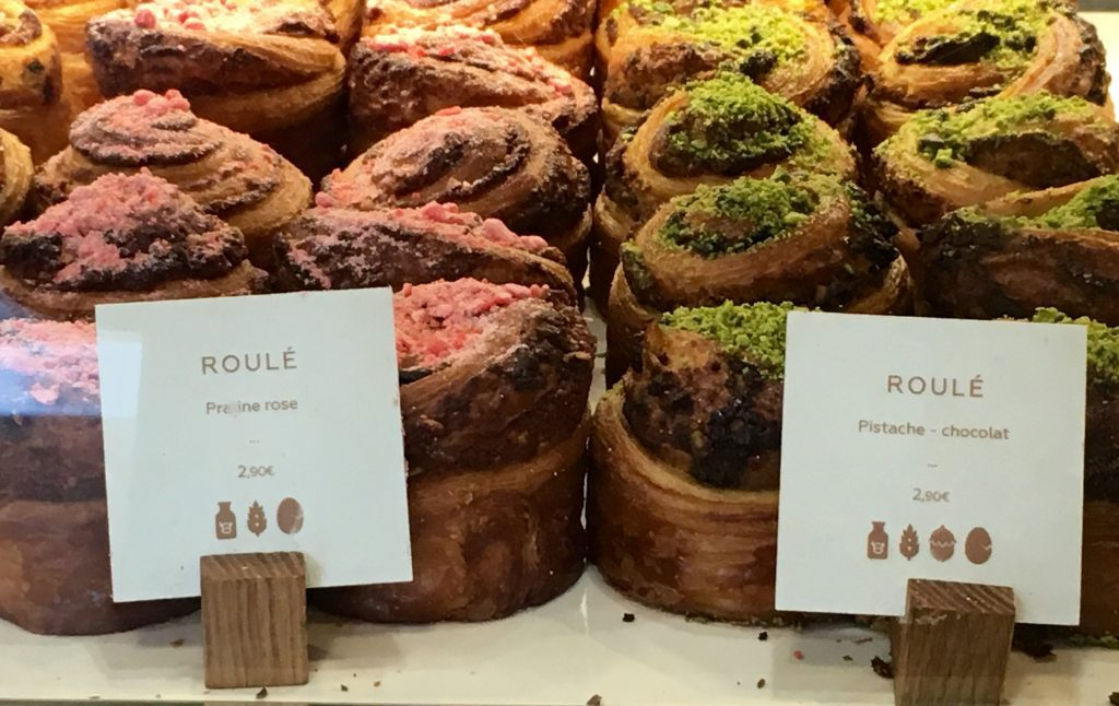 """Pink praline"" and pistachio rolls adorn a window at Yann Couvreur in Paris. Image: Courtney Traub/All rights reserved"