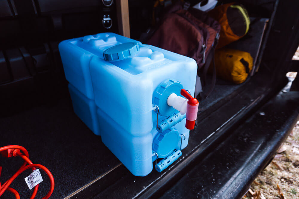 Stackable camping water storage container