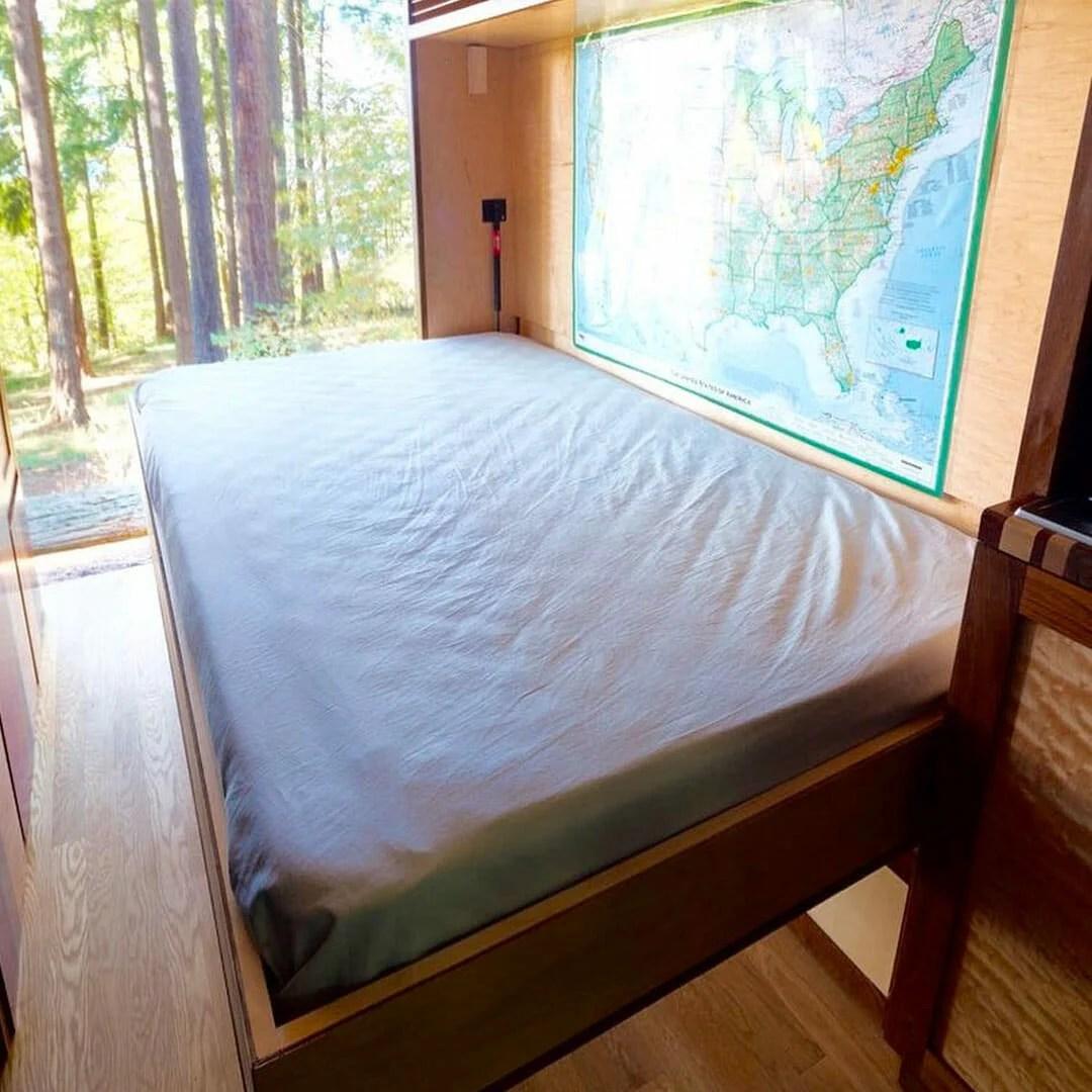 custom built murphy bed design in a camper van conversion for van life